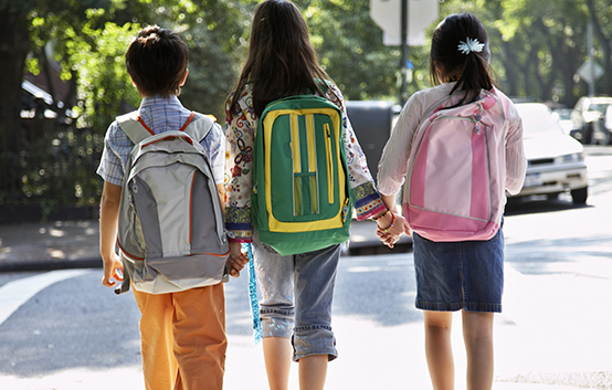 Siblings Walking to School